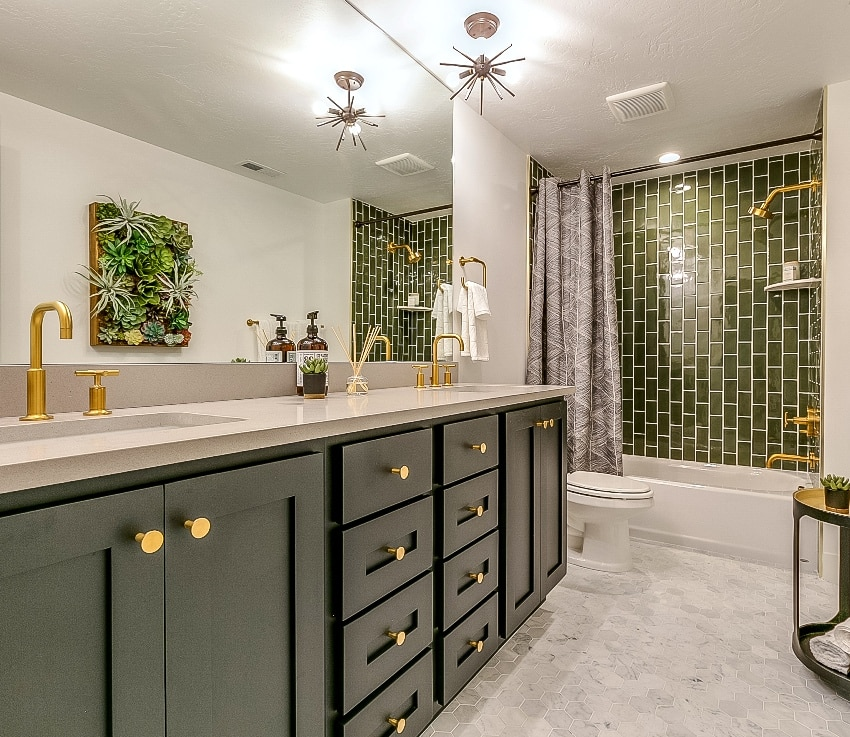 beautiful bathroom with green tile accessory shower wall green drawers a brass faucets and fixtures