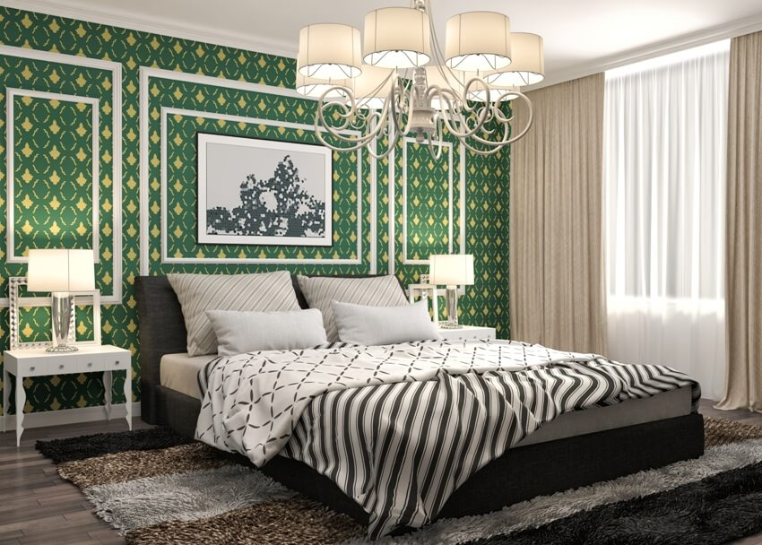 Beautiful bedroom with bed dark color carpet on the floor a green wall accent bedside table with lamp and nice chandelier