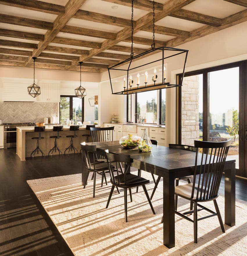 Beautiful dining table off open concept kitchen with dark wood trim