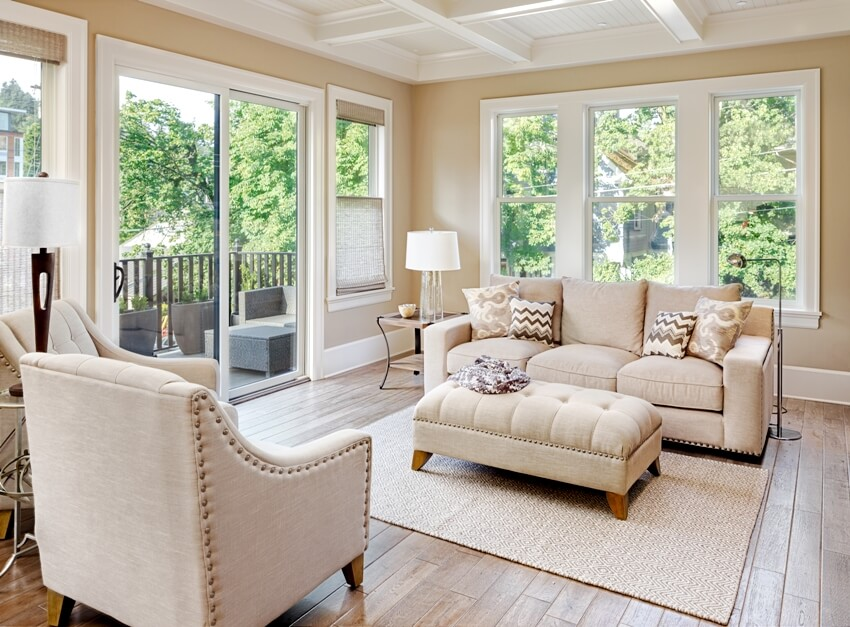 Beautiful living room with furniture hardwood floors and beige carpet