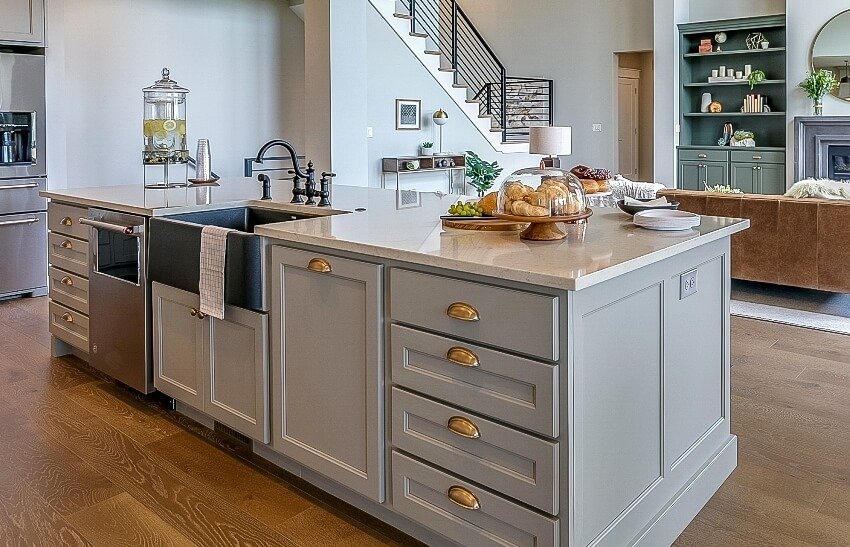 Beautiful modern kitchen with gray kitchen island and wooden floors