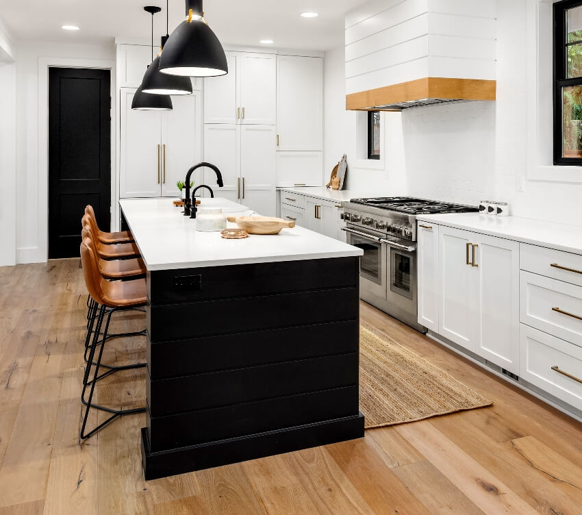 Beautiful white kitchen with black kitchen island trim and dark accents