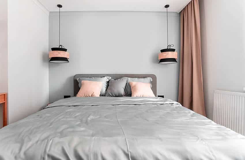 Bed with gray satin sheets