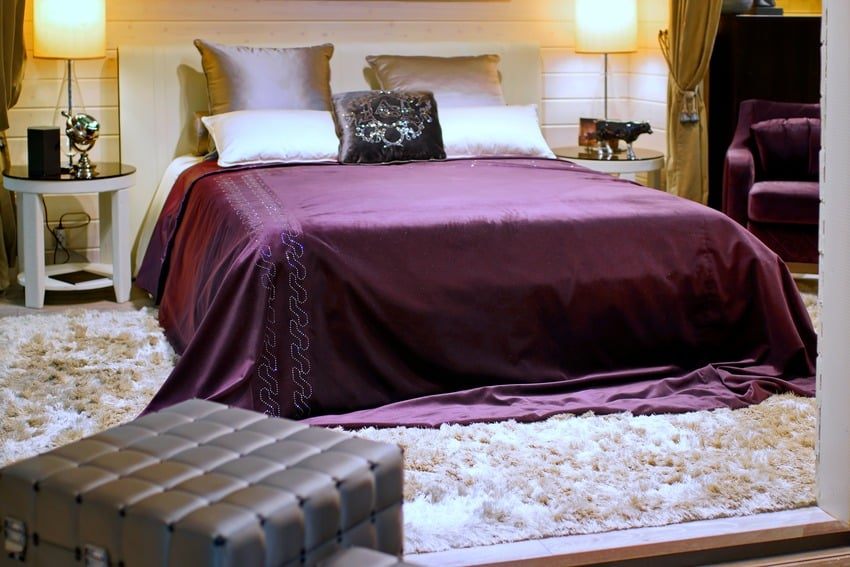 Bed with silk bed sheet and pillow