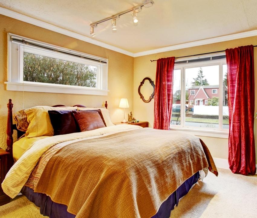 Bedroom interior in dark beige tone with maroon curtains