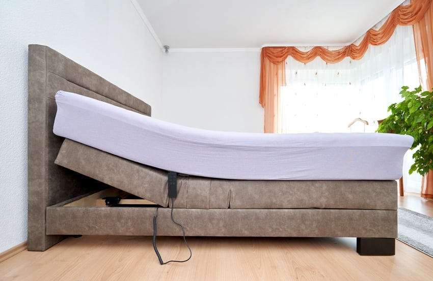 bedroom with bed tilt adjustment mattress