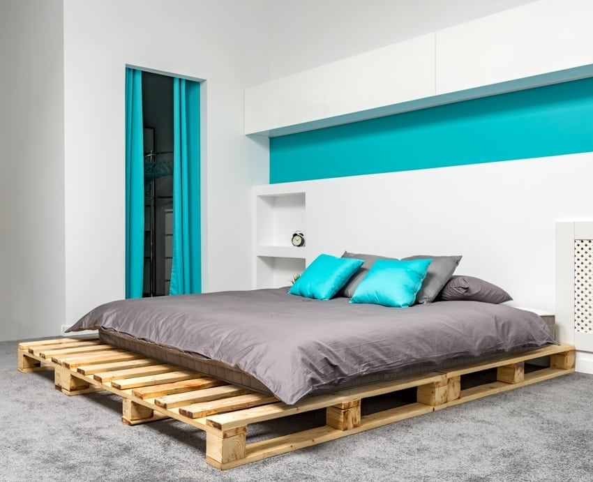 bedroom with big pallet bed and gray turquoise details