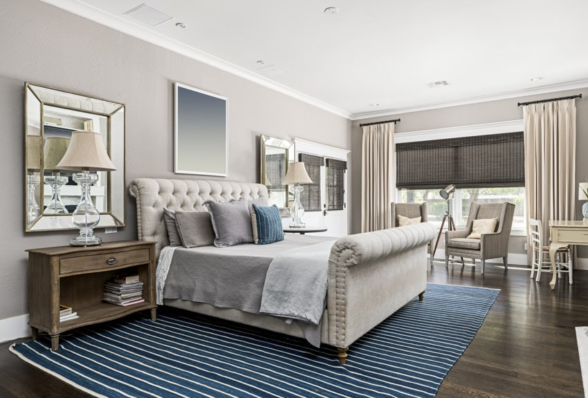 Bedroom with grey and wood furniture pieces and design