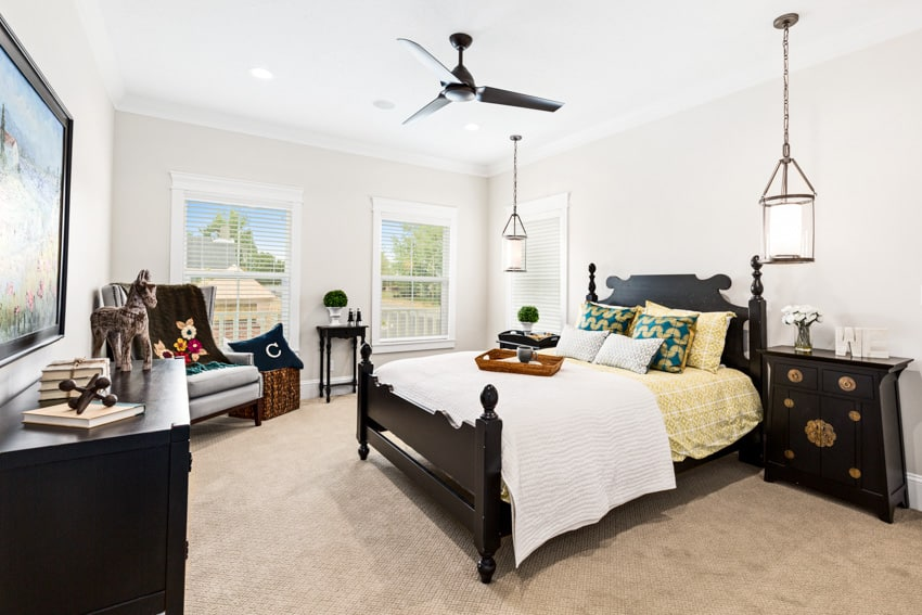 Bedroom with white walls and dark wood furniture