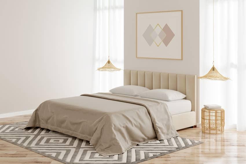 Beige bedroom interior with decorative rug and lighting fixtures