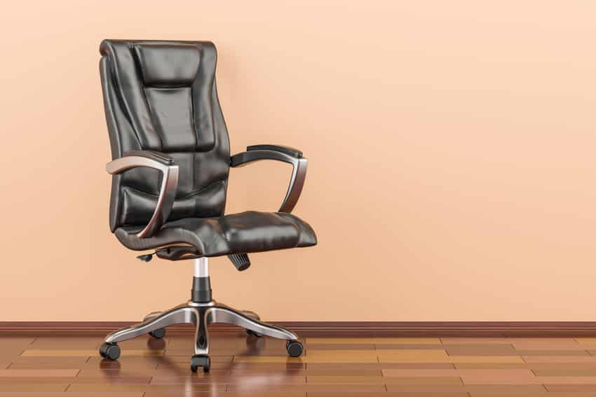 Big and tall black office chair on wooden floor