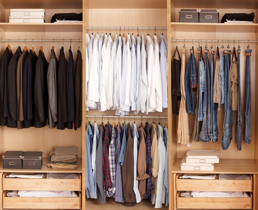 Big wardrobe with color coded organization of male clothes