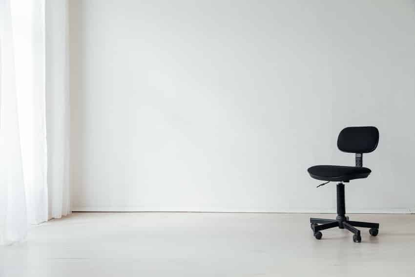 Black drafting stool in an empty office