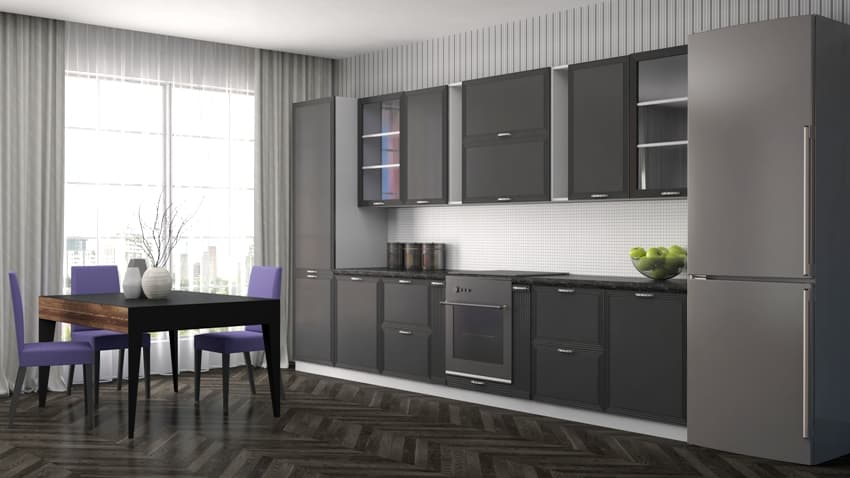 Black kitchen interior with dining table and chairs