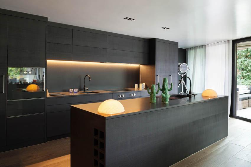 Black kitchen island cabinet lighting wood floor