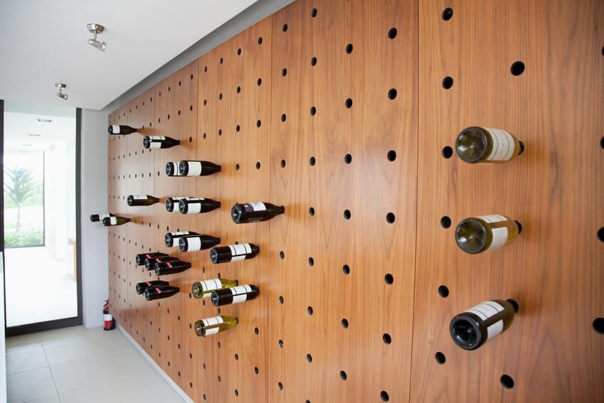Bottles of wine stored in stylish wine rack