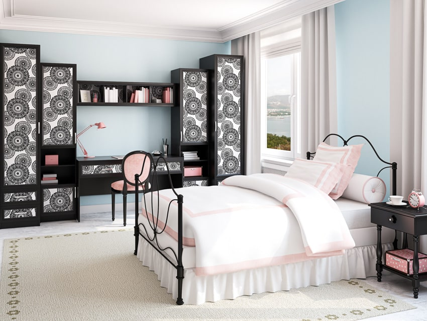 Bright bedroom with black cabinets and bedframe