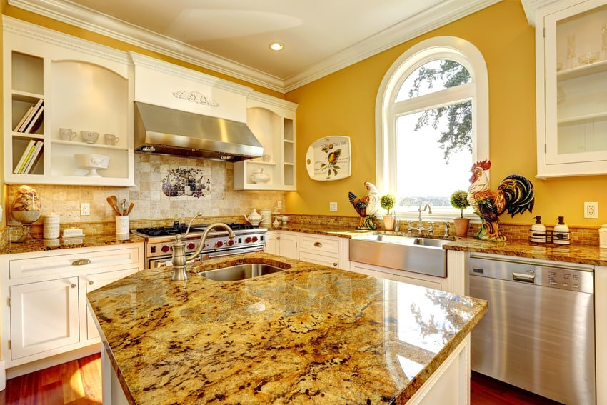 Bright yellow kitchen interior with granite tops