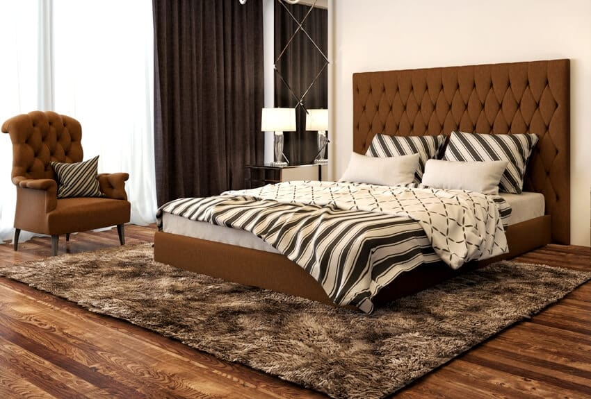 Brown bedroom interior with bed armchair and carpet