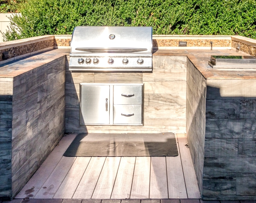 Built in grill with warming drawers at the private deck