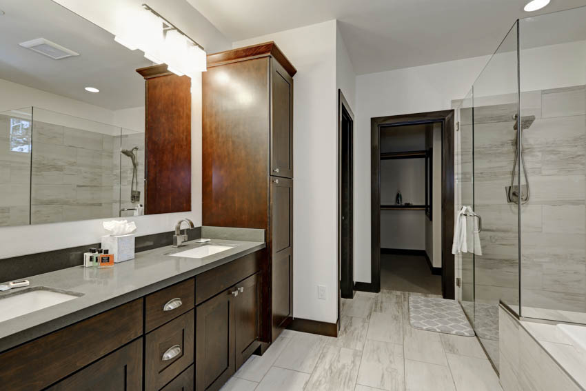 Classic bathroom with countertop mirror wood cabinet drawers shower area