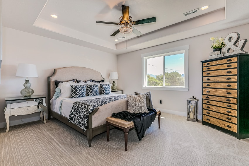 Classic bedroom with dark furniture and ceiling fan