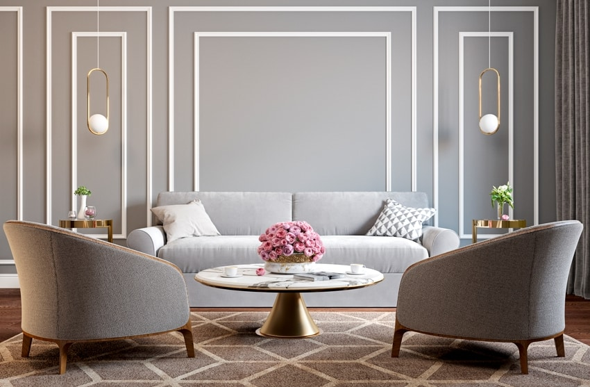 classic gray interior with armchairs sofa coffee table lamps flowers and wall moldings