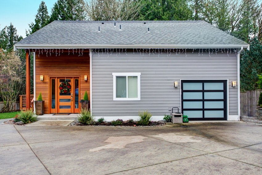 Classic house with gray wall and wood siding