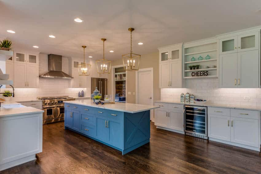 Classic kitchen with wooden floors and blue center island
