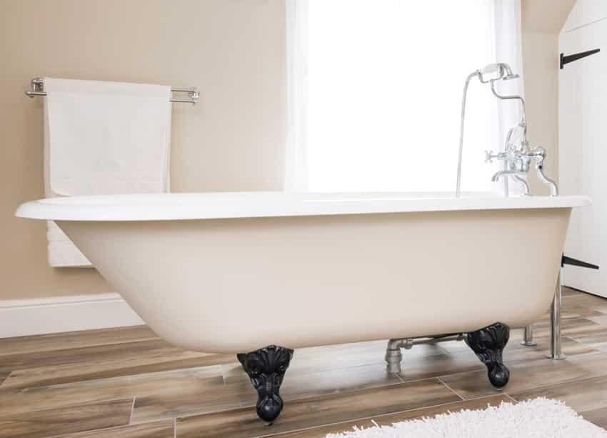 clawfoot bath tub in a modern luxury bathroom interior