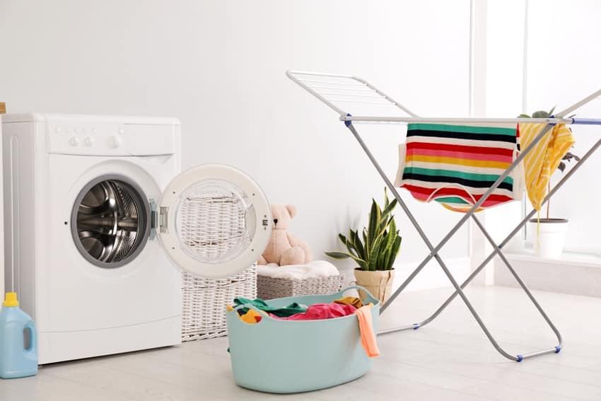 clothes drying rack laundry basket and washing machine