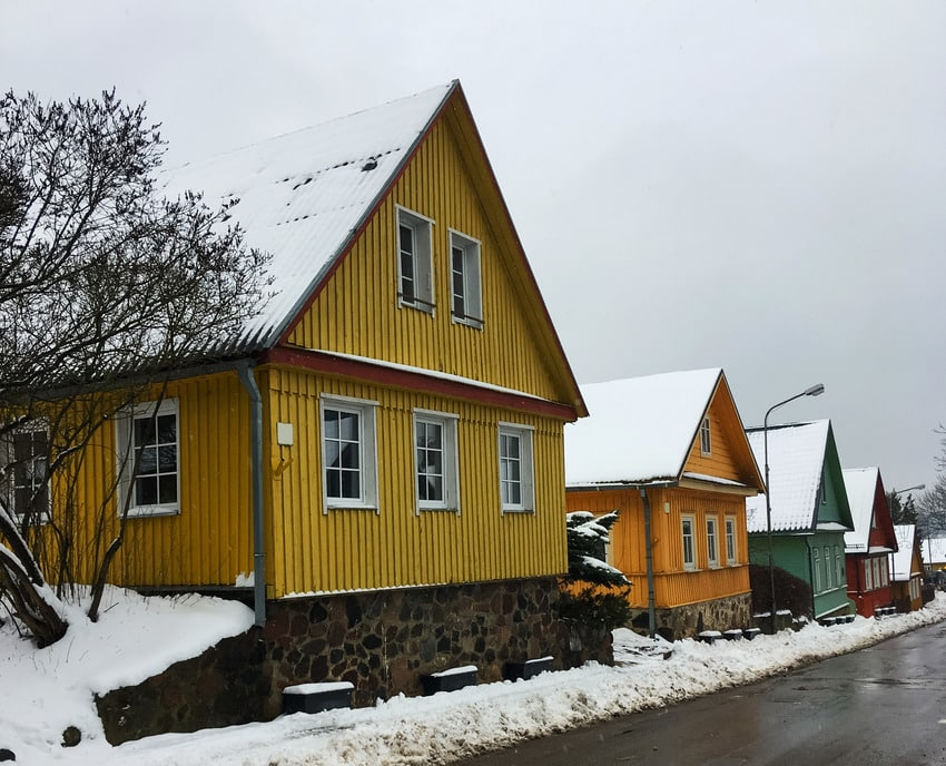 Colorful houses in winter with board and batten siding