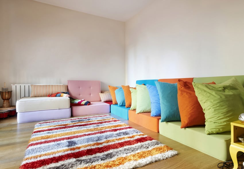 Colorful rug in playful living room interior