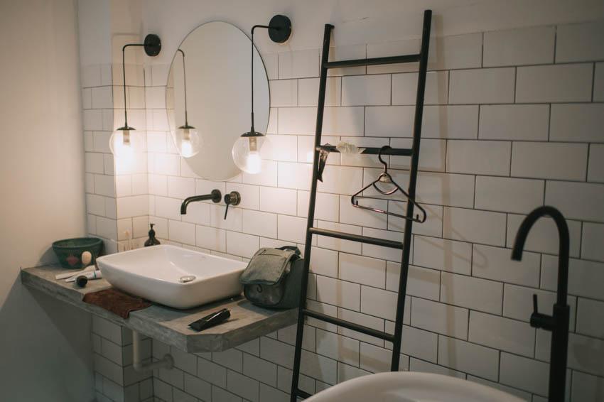 Concrete brick wall bathroom countertop round mirror sink