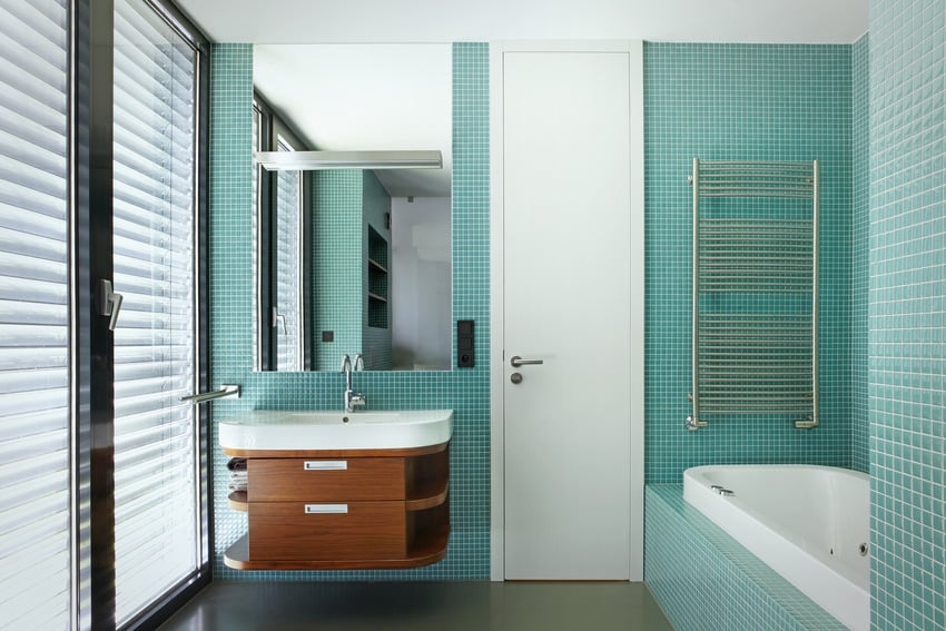Contemporary bathroom with eye catching blue walls wooden sink and bathtub