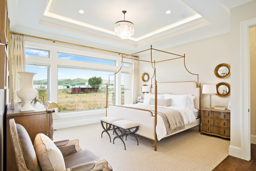 Contemporary bedroom with gold frame white wall wood furniture and ceiling lights