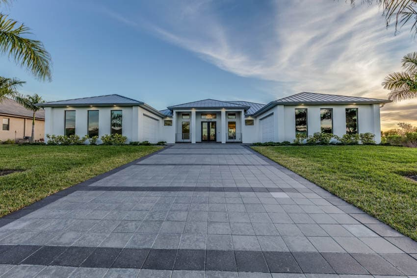 Contemporary house with front lawn and concrete paver driveway