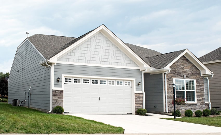 Contemporary house with white garage door and fiber cement siding