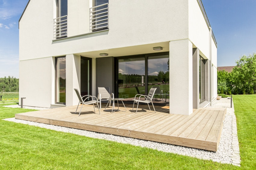 Contemporary white house with small deck