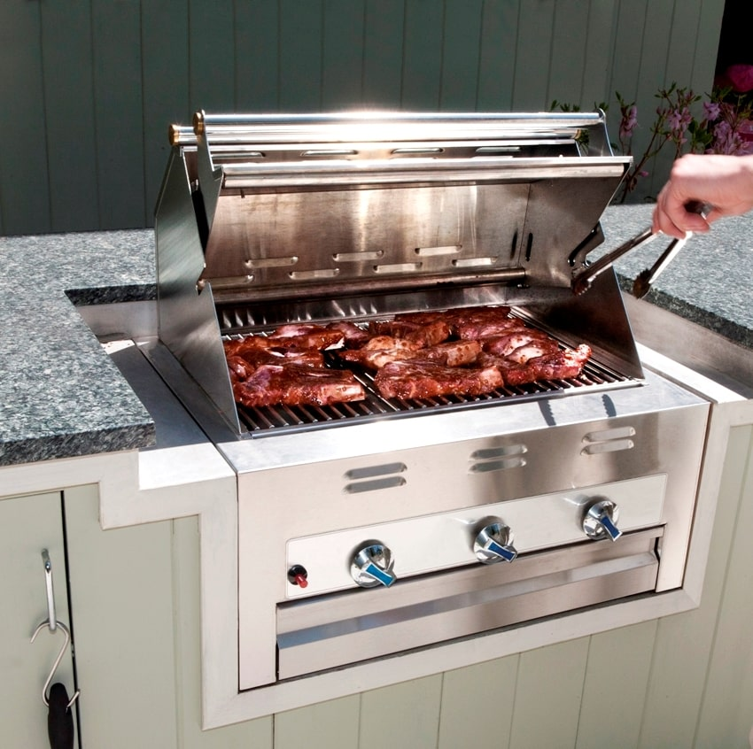 Cooking steaks on a outdoor grill with hybrid fire grilling drawers