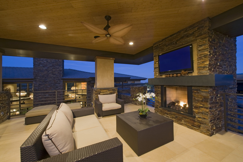 Covered patio with comfy furniture and fireplace