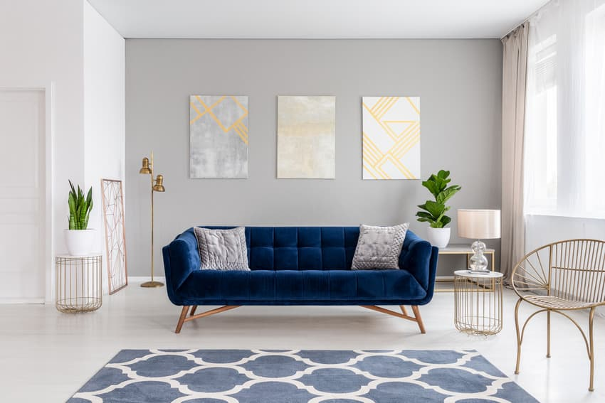 Cozy gray living room interior with blue accents