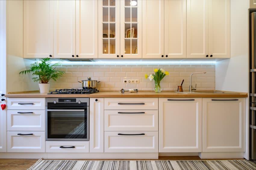 Cozy kitchen with metro tiled walls