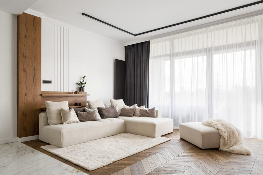 Cozy living room interior with decorative pillows and soft rug