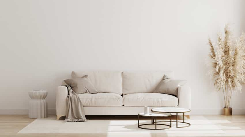 Cozy living room with beige sofa gray pillows and solid rug