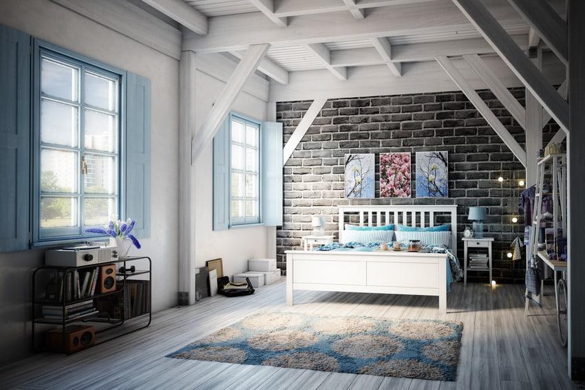 Cozy rustic bedroom in blue black and gray interior