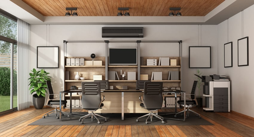 Cozy workplace interior with hanging frames office chairs and wooden flooring