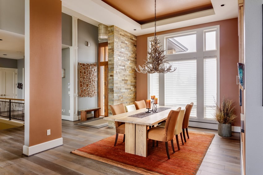 Dining room interior in a luxury home with lighting fixture and rug