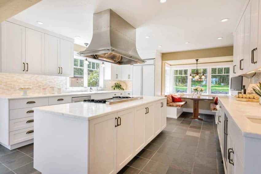 Dining nook in kitchen with center island hood cabinets drawers