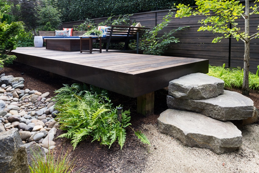 Elevated wood deck with landscaped rock features
